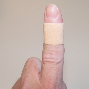 cut finger with plaster